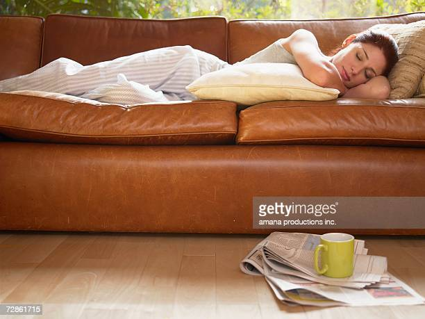 Young woman sleeping on sofa