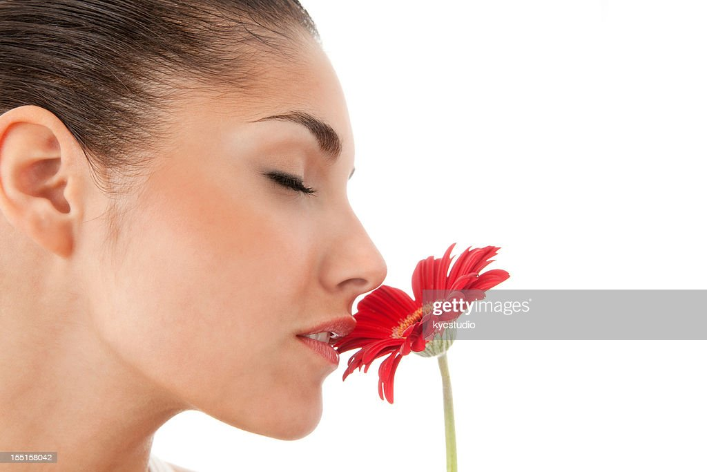 Young Woman Smelling a Red Flower - Isolated : Stock Photo