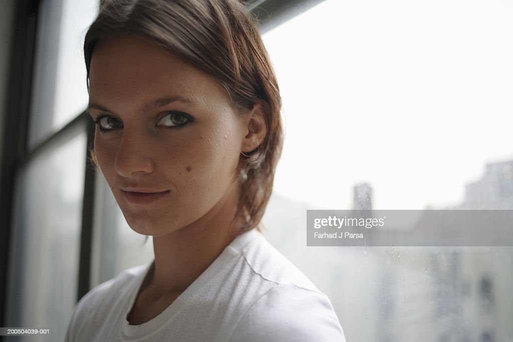 Young woman smiling, close-up, portrait : Stock Photo