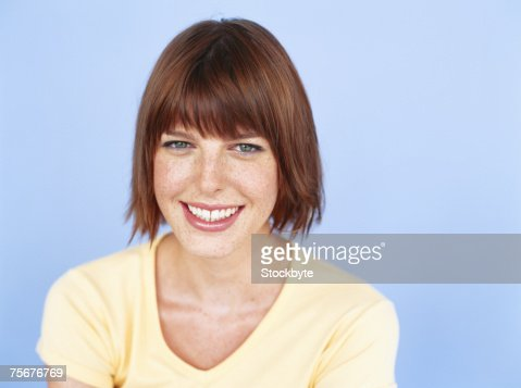 Young woman smiling, close-up, portrait