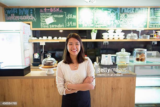 Young woman smiling in coffee shop.