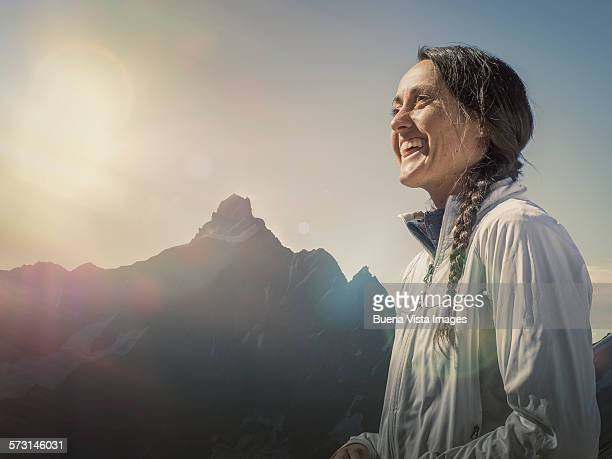 Young woman smiling in the mountains