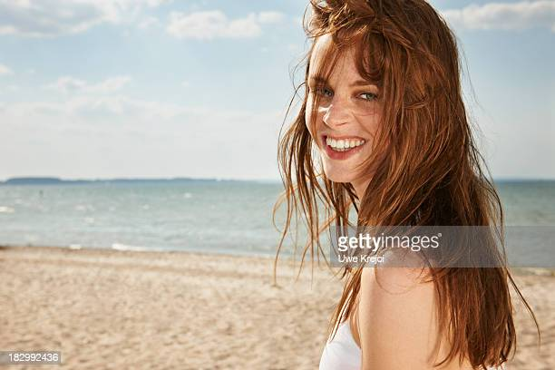 Young woman smiling on beach