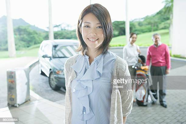 Young woman smiling outside of hotel