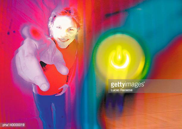 Young woman smiling, pointing toward camera, digital composite.