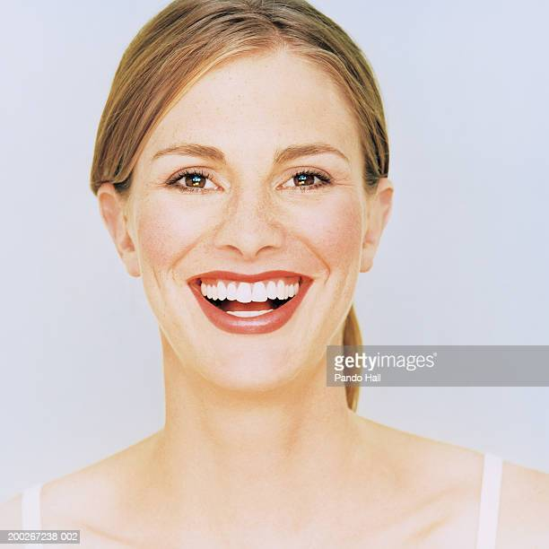 Young woman smiling, portrait, close-up