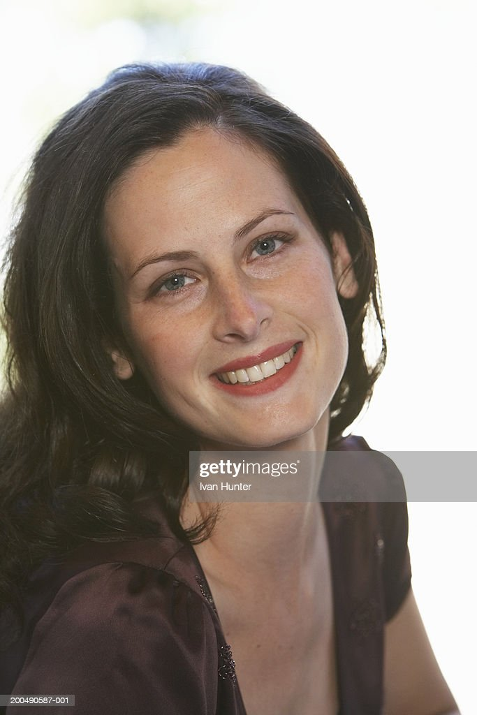 Young woman smiling, portrait : Stock Photo