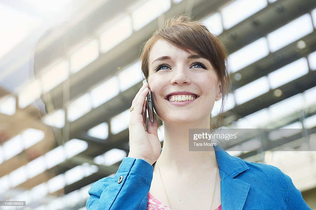 young woman smiling talking on mobile phone : Stock Photo