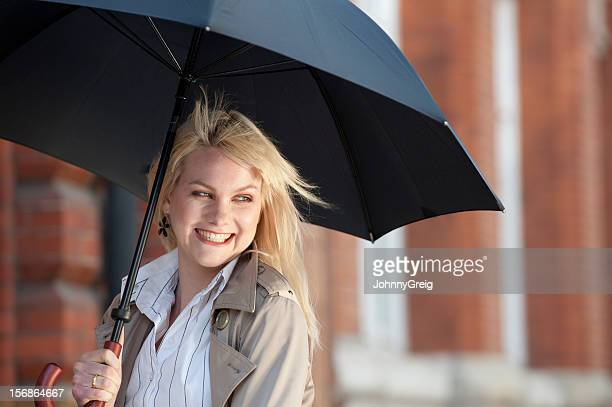 Young Woman Smiling with Umbrella