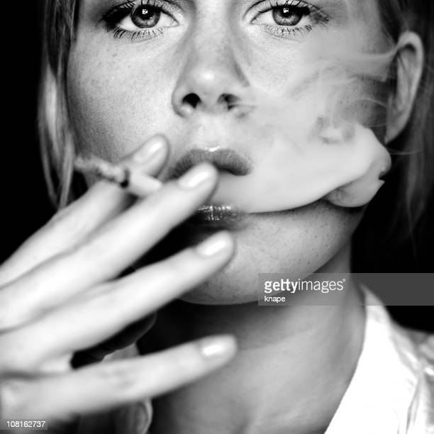 Young Woman Smoking Cigarette, Black and White