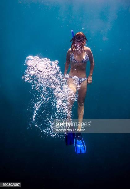 Young woman snorkeling in ocean.