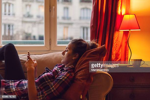 Young woman spending the weekend at home