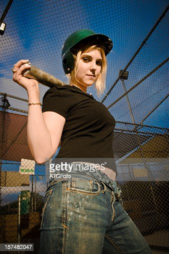 Young Woman Sporting a Baseball Bat and Hat