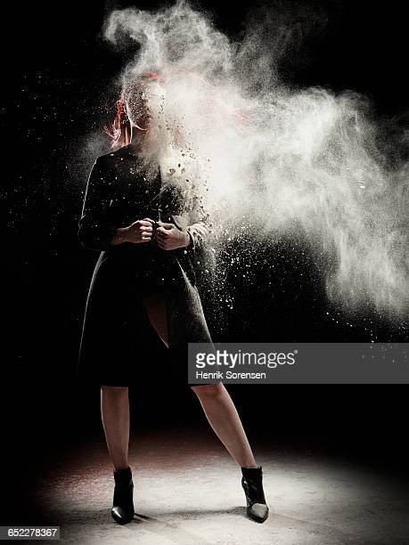young woman sprayed by powder
