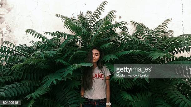 Young Woman Standing Amidst Plants