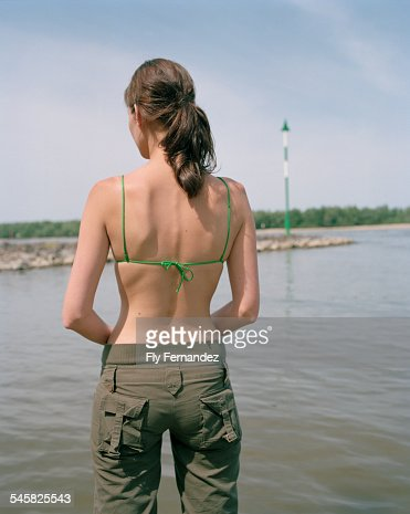 Young woman standing at a lake