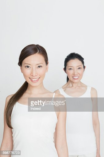 Young woman standing front of mature woman