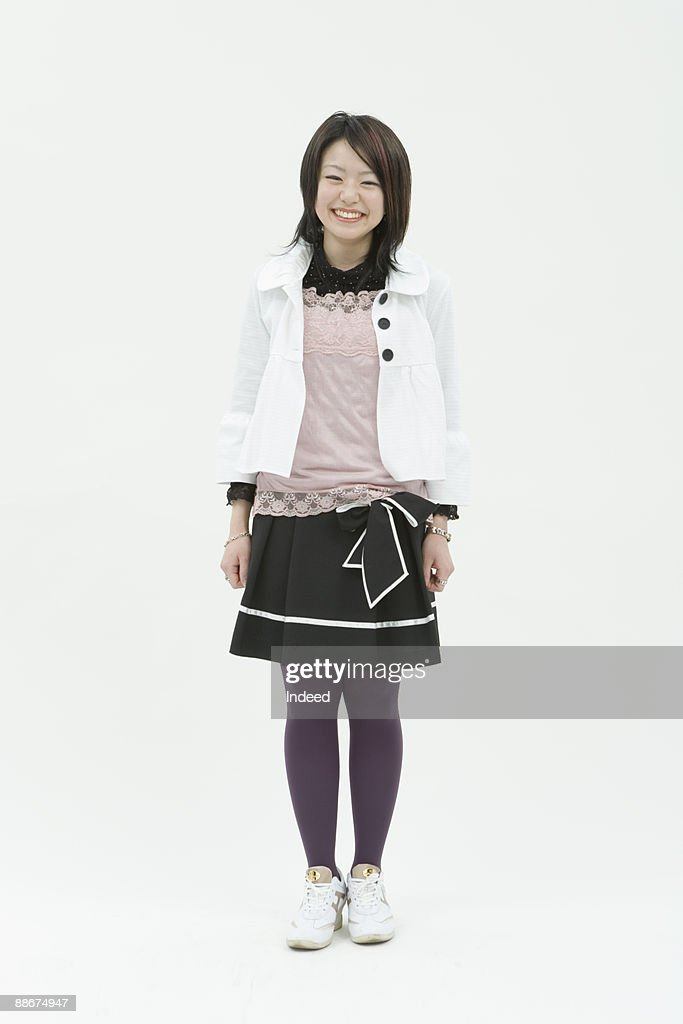 Young woman standing, full length, portrait : Stock Photo