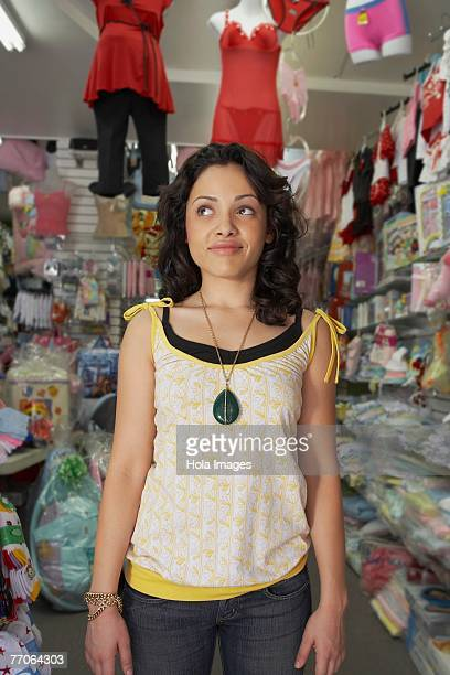 Young woman standing in a baby shop