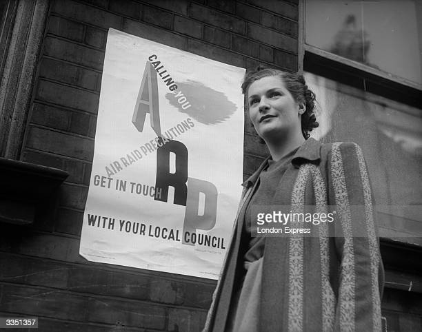 A young woman standing in front of a poster promoting the ARP