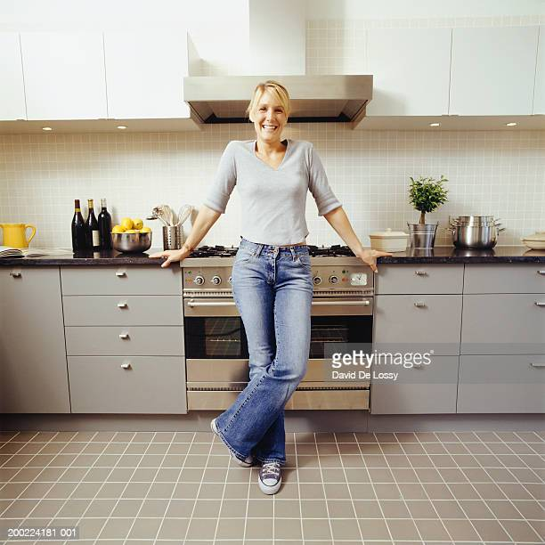 Young woman standing in kitchen, portrait