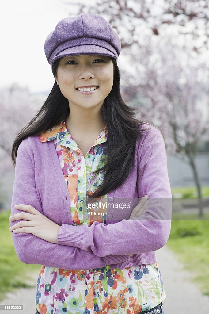 Young woman standing in park, portrait : Stock Photo