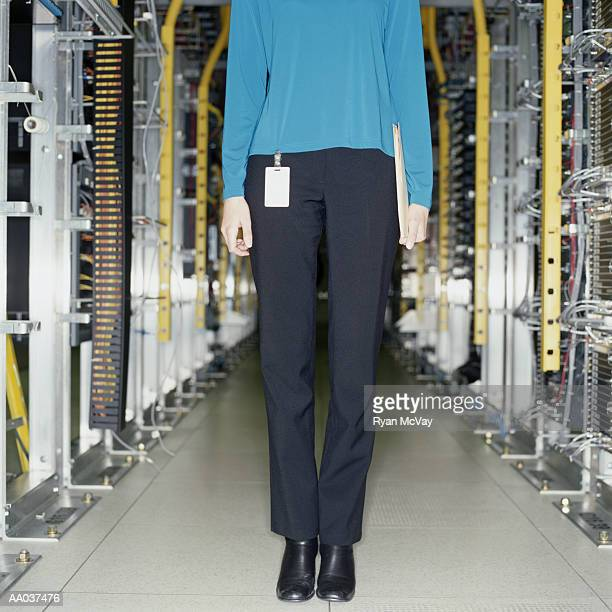 Young Woman Standing in Server Room