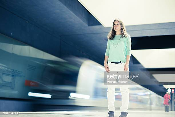 Young woman standing in subway station