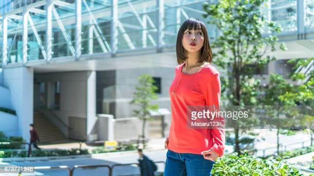 Young woman standing in Tokyo