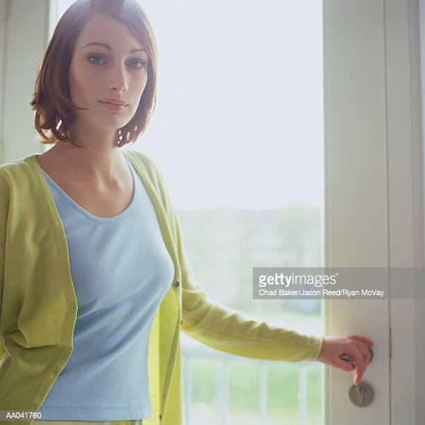 Young Woman Standing Near Door
