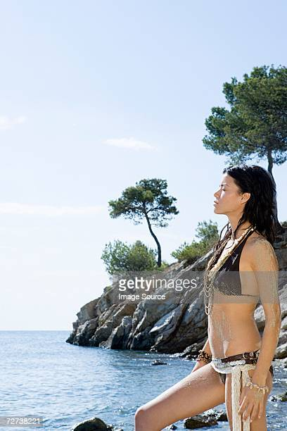 Young woman standing near sea