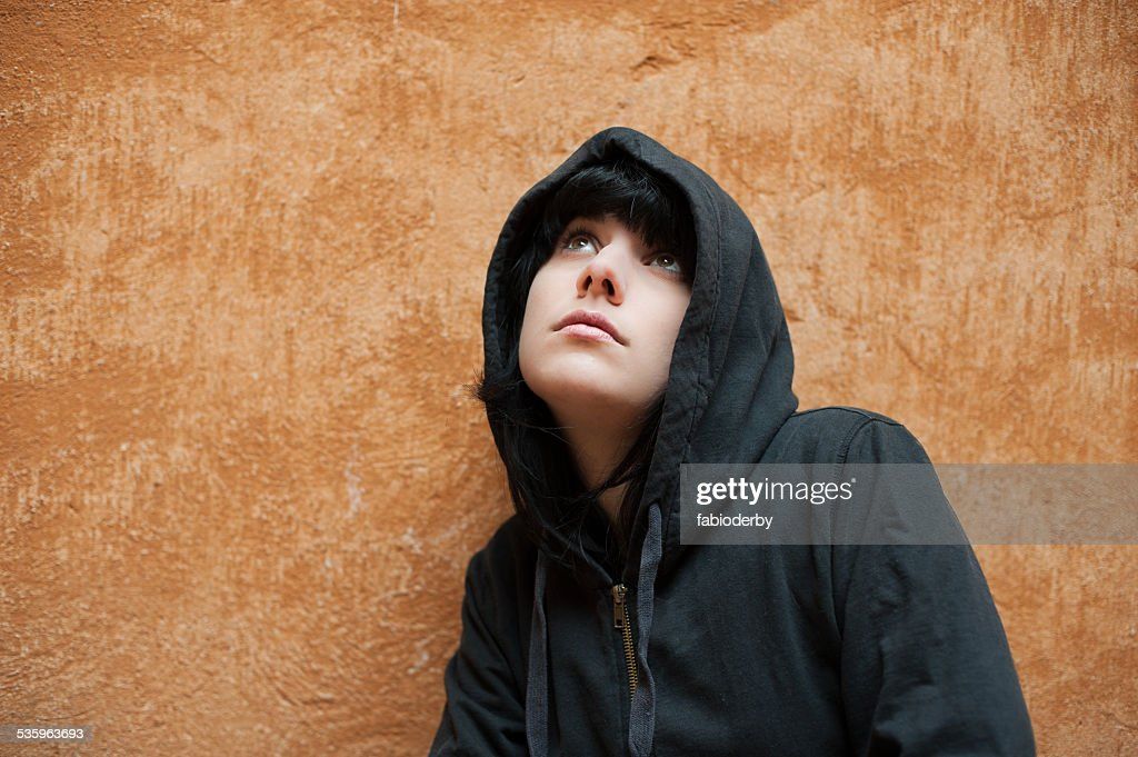 Young woman standing near urban wall portrait : Stock Photo