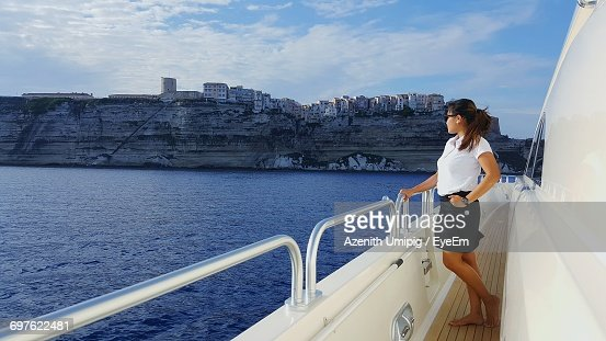 Young Woman Standing On Boat Deck