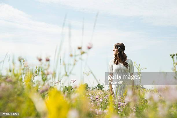 Young woman standing on flower meadow