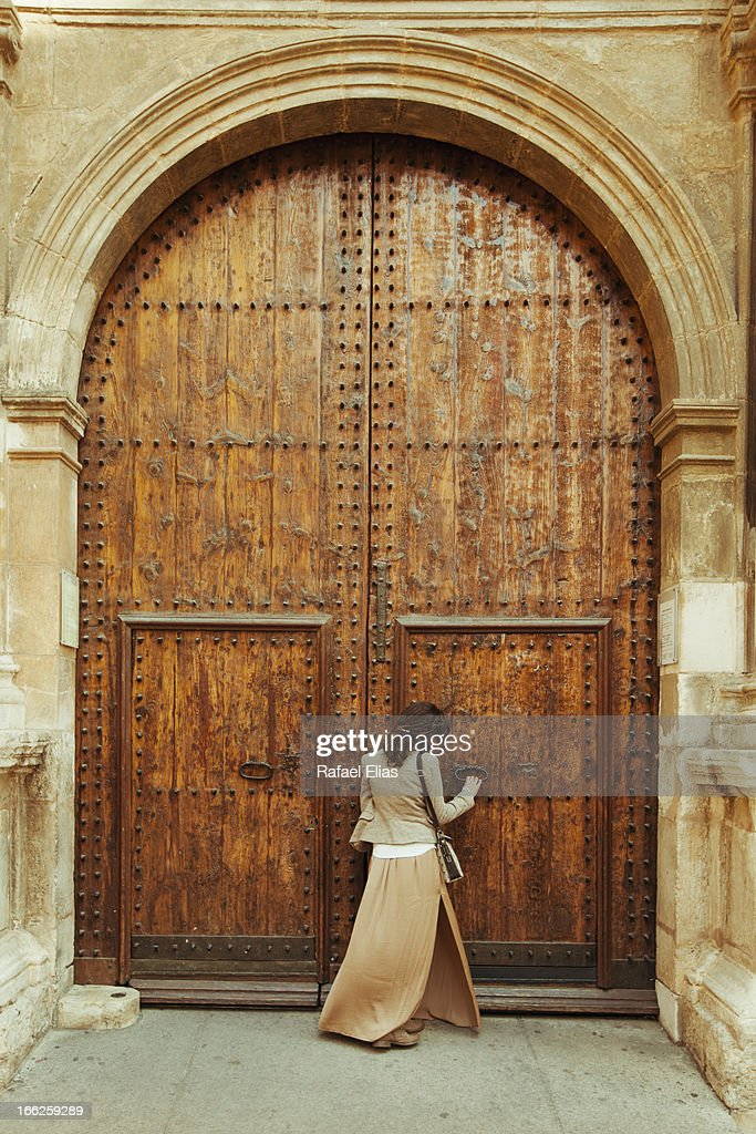 Young woman standing outside church door
