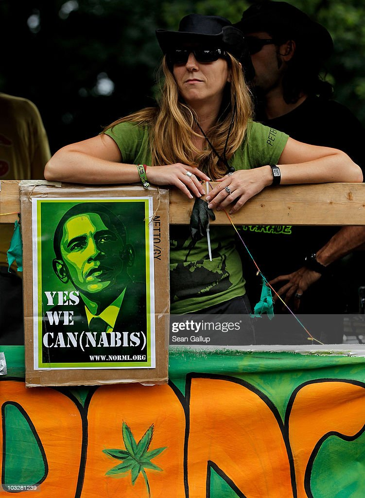 A young woman stands on a truck next to a an artist's satirical portrait of U.S. President Barack Obama while marching in support of the legalization of marijuana in Germany during the annual Hemp Parade, or 'Hanfparade', on August 7, 2010 in Berlin, Germany. The consumption of cannabis in Germany is legal, though all other aspects, including growing, importing and selling it, are not. However, since the introduction of a new law in 2009, the sale and possession of marijuana for licenced medicinal use is legal.