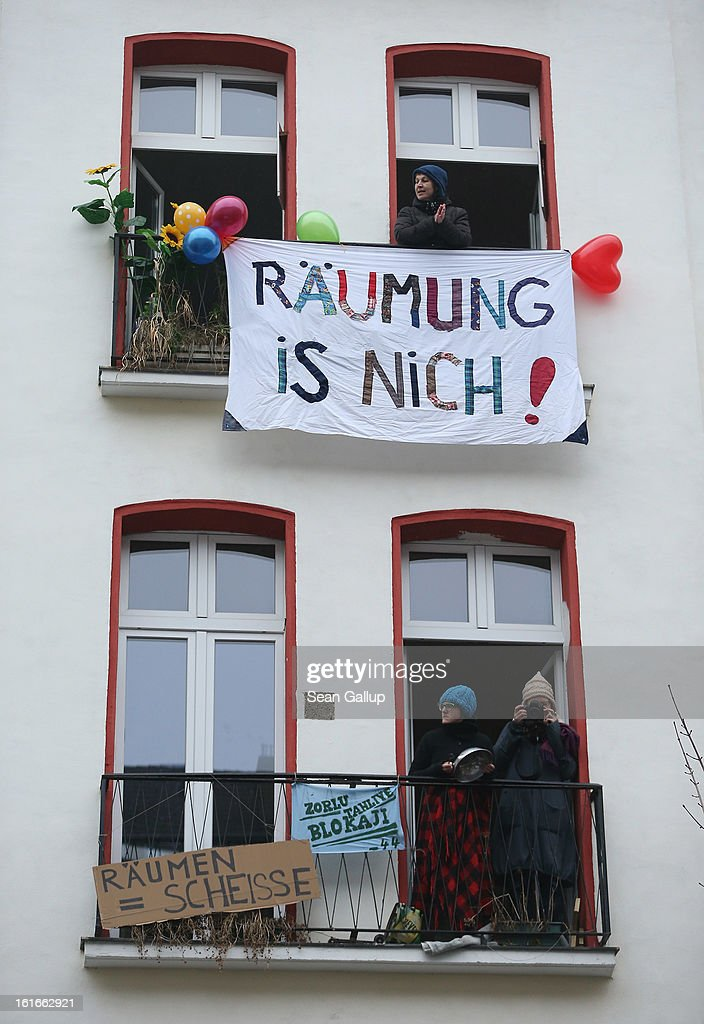 A young woman stands over a banner that reads: 'No Eviction!' from her window at Lausitzer Strasse 8 in rpotest against the eviction of the German-Turkish Gulbol family from an apartment in the same house on February 14, 2013 in Berlin, Germany. Several hundred protesters arrived to demonstrate in support of Ali Gulbol, his wife and two sons, who face eviction from their apartment in Kreuzberg district despite the fact that they invested EUR 20,000 into their apartment and have paid all their outstanding rent, albeit behind schedule. The case is highlighting an ongoing controversy over gentrification in parts of Berlin, where rising housing prices are luring investors and forcing long-standing tenants out.