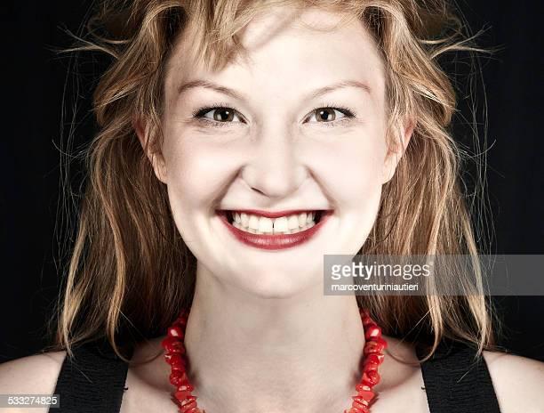 Young woman staring hypnotically at camera
