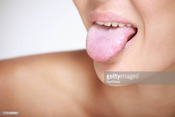 young woman sticking out tongue, close-up