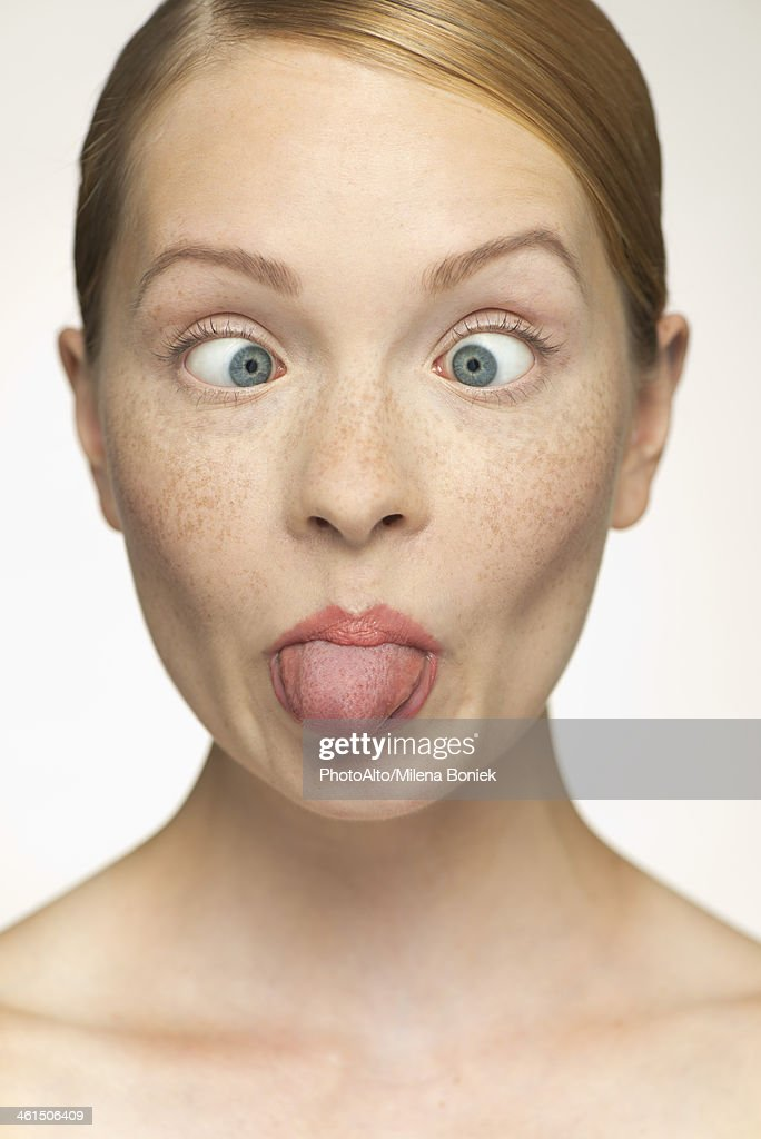 Young woman sticking out tongue