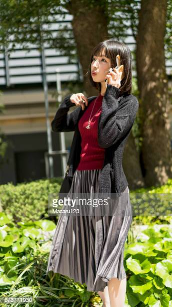 young woman stopped to talking on a phone