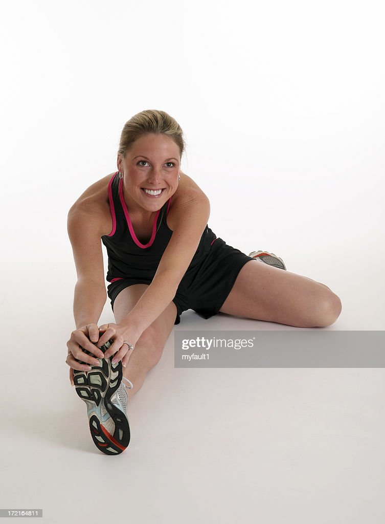 Young woman stretching legs