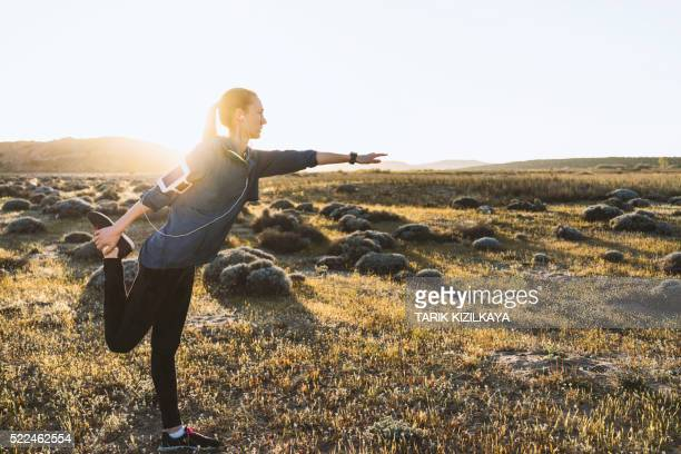Young woman stretching on a sunny day