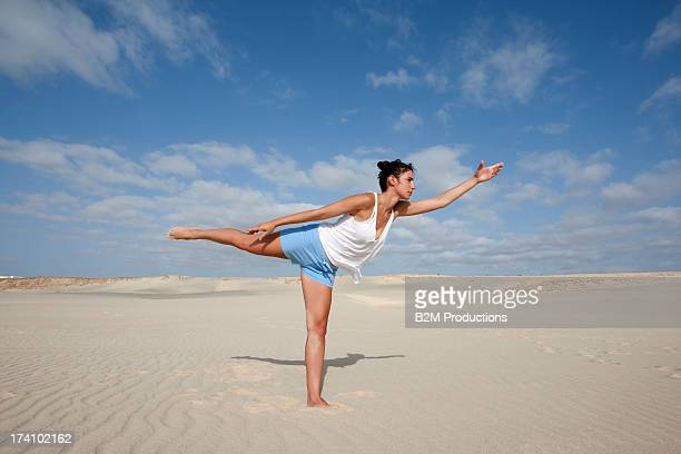 Young Woman Stretching On Beach