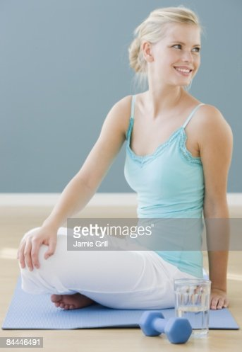 Young Woman stretching on yoga mat