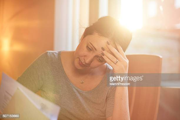 young woman struggling with the bills