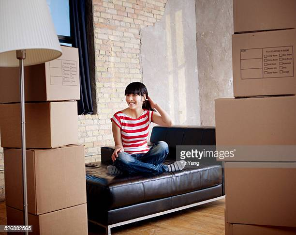 Young Woman Student Moving Apartment