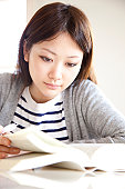 Young Woman Studying at Desk