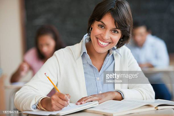 Young woman studying in classroom