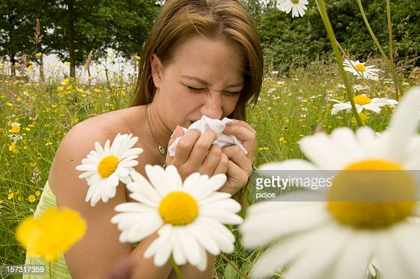 young woman suffering from hay fever
